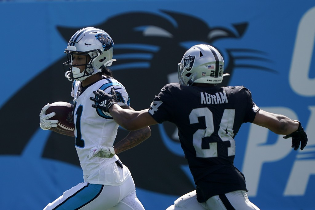 Carolina Panthers wide receiver Robby Anderson, left, scores past Las Vegas Raiders safety Johnathan Abram during the second half of an NFL football g...