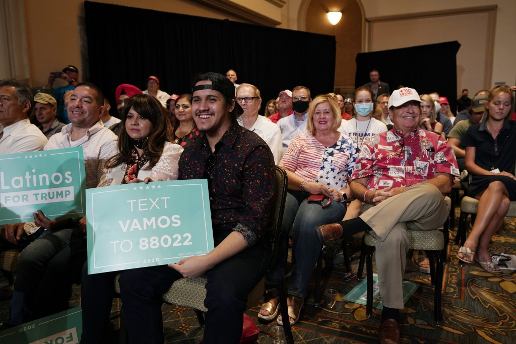 The crowd listens to President Donald Trump speak as he participates in a Latinos for Trump Coalition roundtable Monday, Sept. 14, 2020, in Phoenix. (...