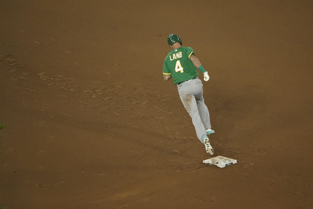 Oakland Athletics' Jake Lamb rounds the bases after hitting a solo home run against the Seattle Mariners during the sixth inning of the second basebal...