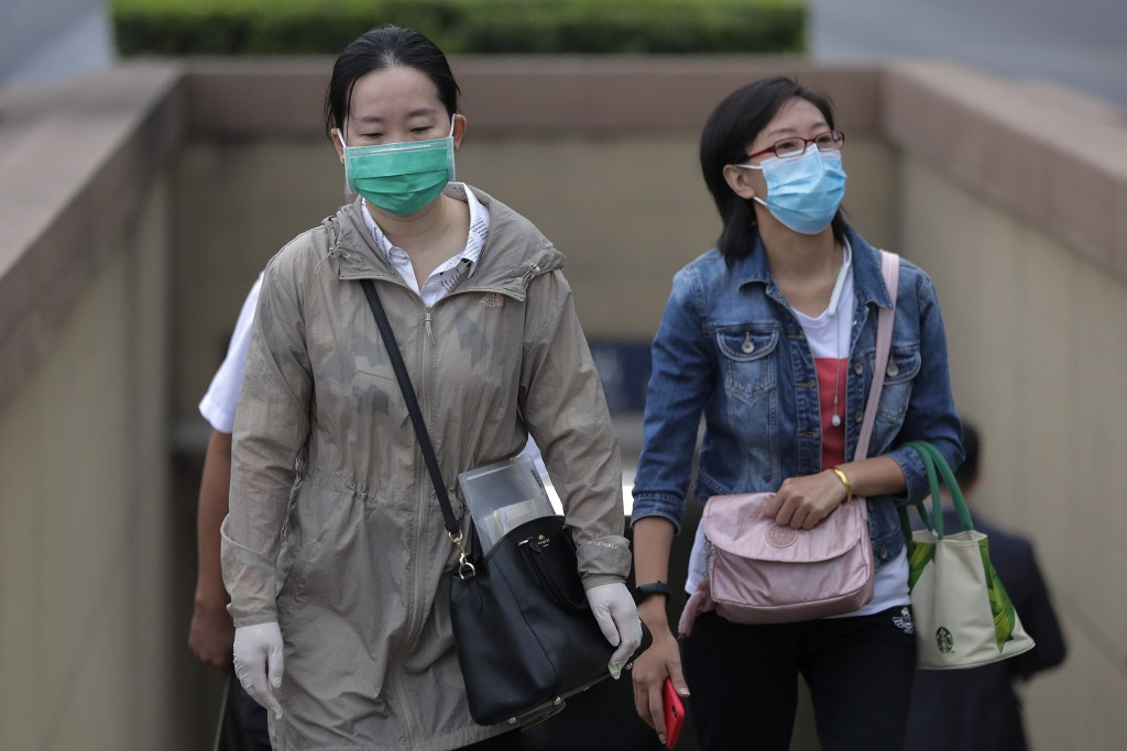 Women wearing face masks to help curb the spread of the coronavirus walk out from a subway station in Beijing, Tuesday, Sept. 15, 2020. Even as China ...