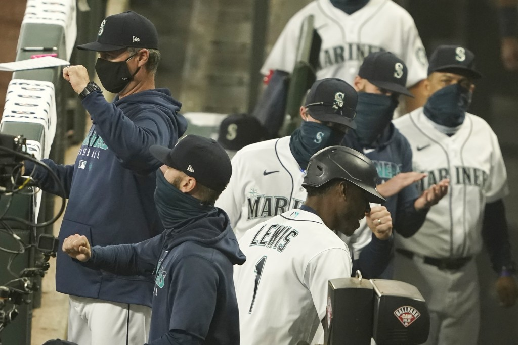 Seattle Mariners' Kyle Lewis (1) is greeted in the dugout after he hit a two-run home run against the Oakland Athletics during the fifth inning of the...