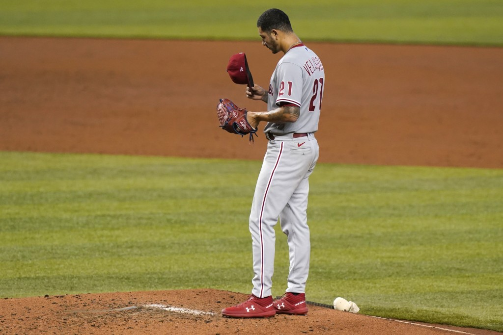 Philadelphia Phillies starting pitcher Vince Velasquez adjusts his cap during the third inning of a baseball game against the Miami Marlins, Monday, S...