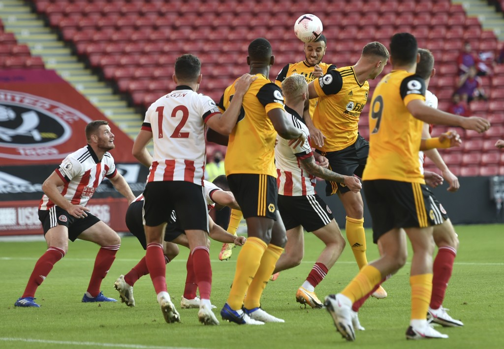 Wolverhampton Wanderers' Romain Saiss heads in his sides second goal during the English League Cup soccer match between Sheffield United and Wolves at...