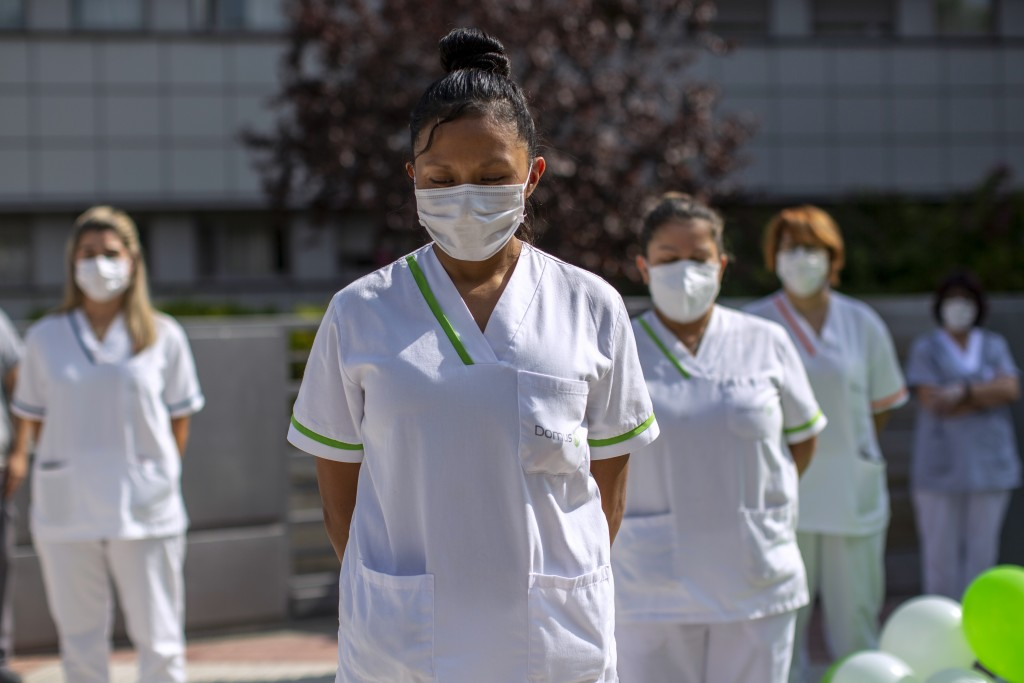 """Workers of a nursing home """"DomusVi Arturo Soria"""" hold a minute of silence in support of the social and health sector and its workers in Madrid, Spain,..."""