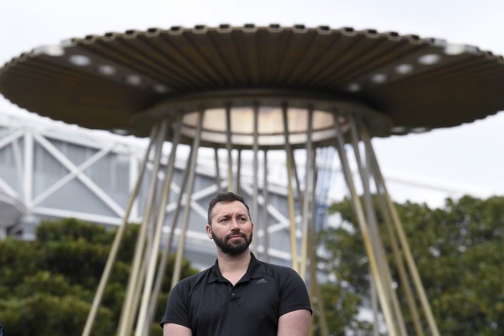 Australian Olympian Ian Thorpe stands in front of the Sydney 2000 Olympic Cauldron as it's lit to celebrate the 20th anniversary of the Sydney 2000 Ol...