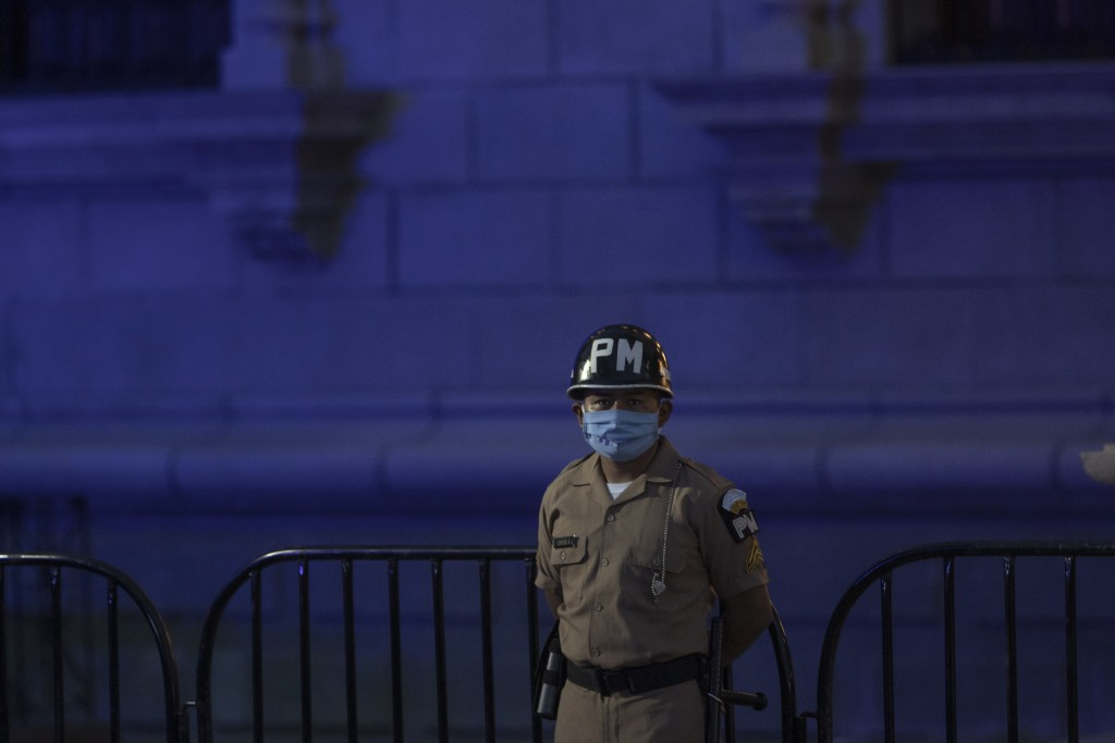 A soldier wearing a protective face mask as a precaution against the spread of the coronavirus stands guard at the Constitution square during the inde...