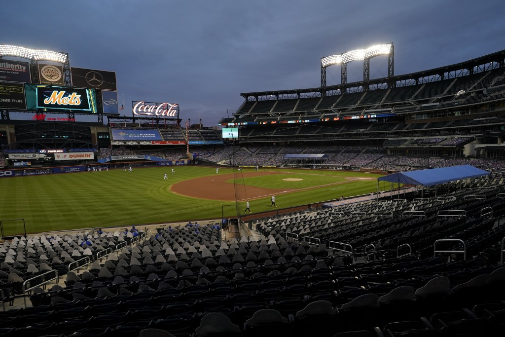 FILE - In this Sept. 9, 2020, file photo, Citi Field is viewed at dusk before a baseball game between the New York Mets and the Baltimore Orioles in N...