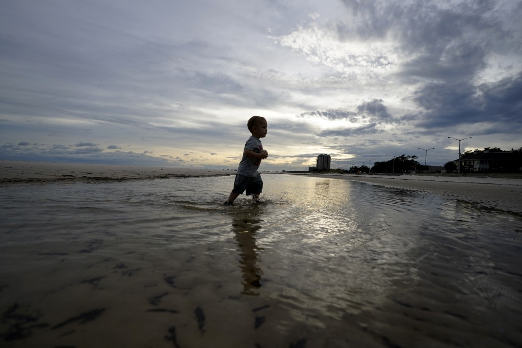 Vinny Pero, 2, walks in a tidal pool on the beach along the Gulf of Mexico in Biloxi, Miss., with his mother, not pictured, Monday, Sept. 14, 2020. Hu...