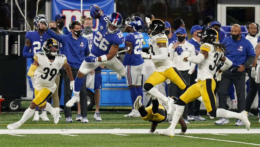 New York Giants running back Saquon Barkley (26) leaps to avoid being tackled by the Pittsburgh Steelers during the second quarter of an NFL football ...