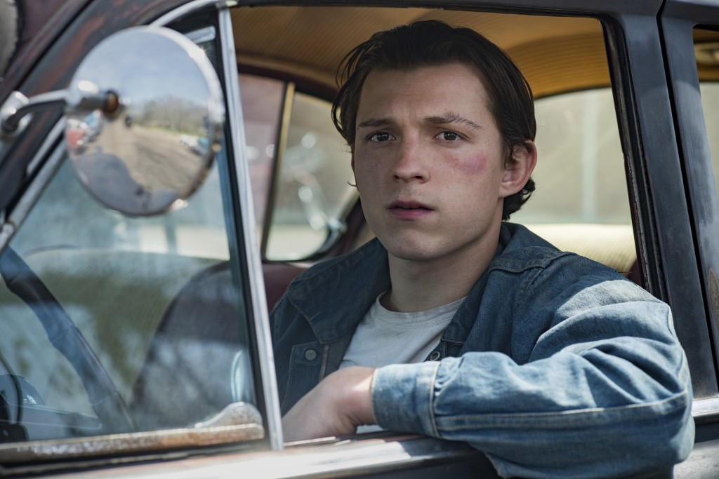 "This image released by Netflix shows Tom Holland in a scene from ""The Devil All The Time."" (Glen Wilson/Netflix via AP)"