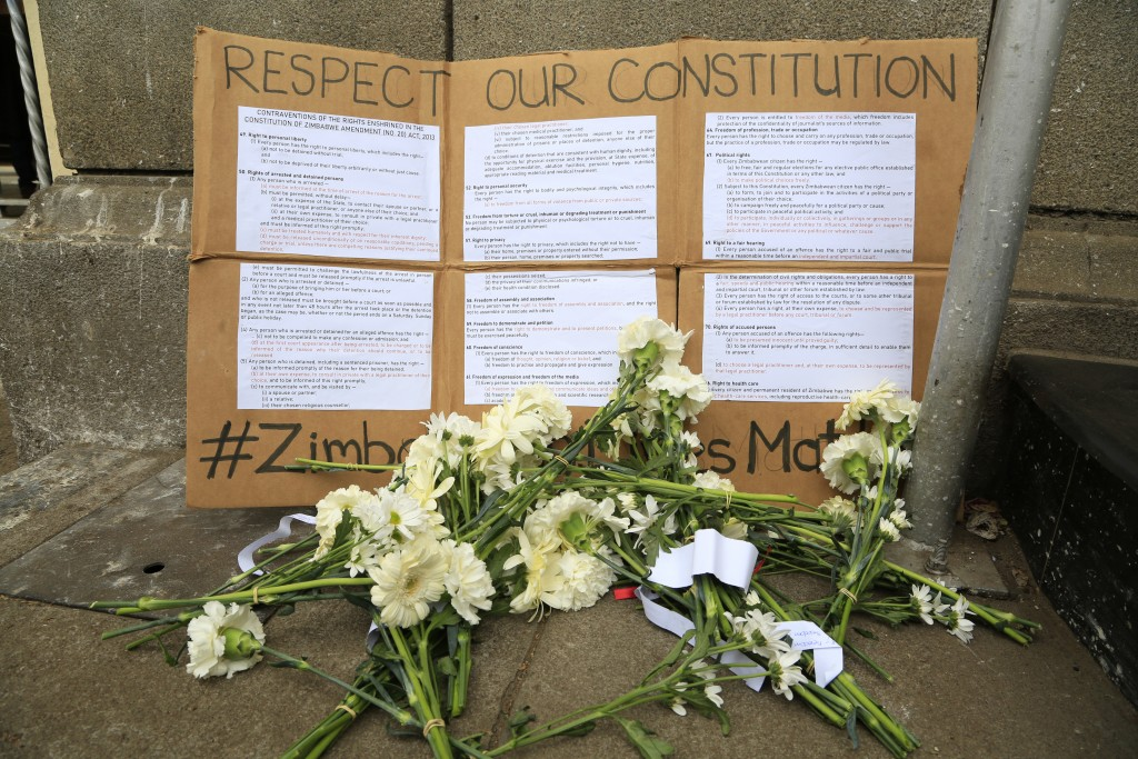 Flowers are placed outside the High Court during a peaceful protest by Zimbabwe lawyers over abuse of power by the courts in Harare, Wednesday Sept, 2...