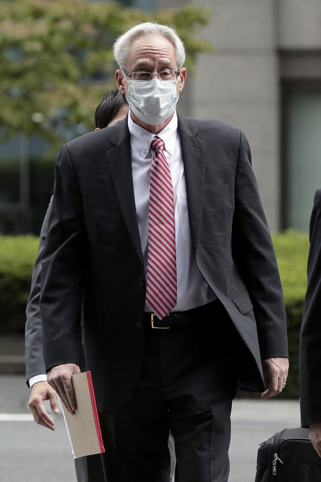 Former Nissan Motor Co. executive Greg Kelly arrives for the first trial hearing at the Tokyo District Court in Tokyo Tuesday, Sept. 15, 2020. The fin...