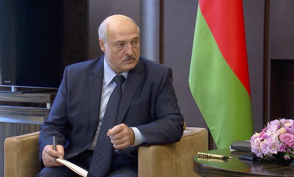 In this photo taken from video and released by Russian Presidential Press Service, Belarusian President Alexander Lukashenko talks with Russian Presid...