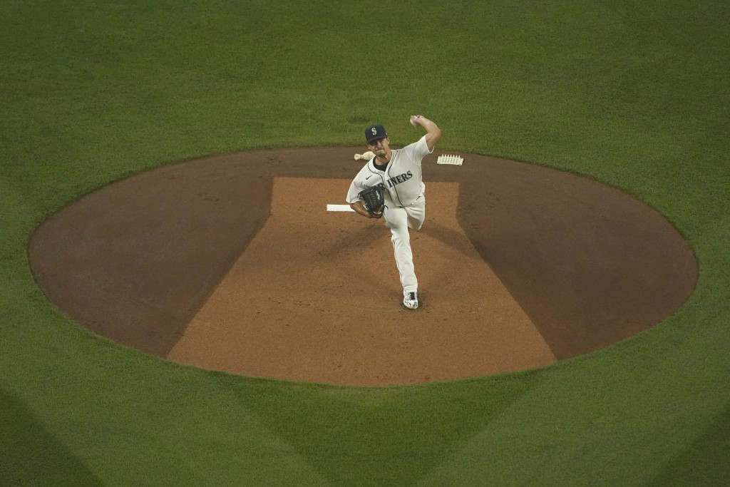 Seattle Mariners starting pitcher Marco Gonzales throws against the Oakland Athletics during the first inning of the first baseball game of a doublehe...