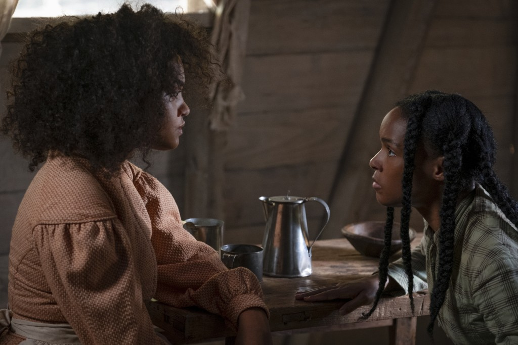 """This image released by Lionsgate shows Kiersey Clemons, left, and Janelle Monae in a scene from """"Antebellum."""" (Matt Kennedy/Lionsgate via AP)"""