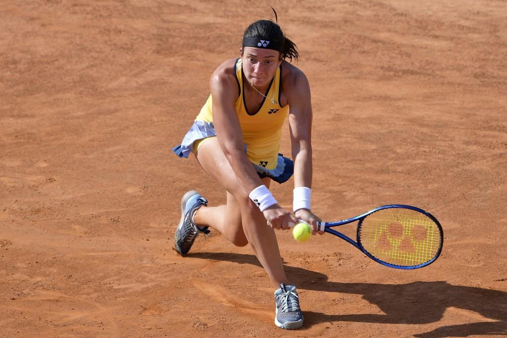 Latvia's Anastasija Sevastova returns the ball to Italy's Jasmine Paolini during their match at the Italian Open tennis tournament, in Rome, Monday, S...