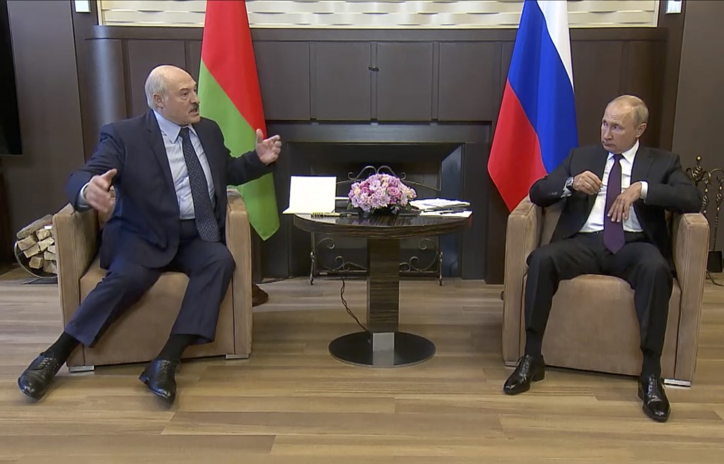 In this photo taken from video and released by Russian Presidential Press Service, Russian President Vladimir Putin, right, and Belarusian President A...