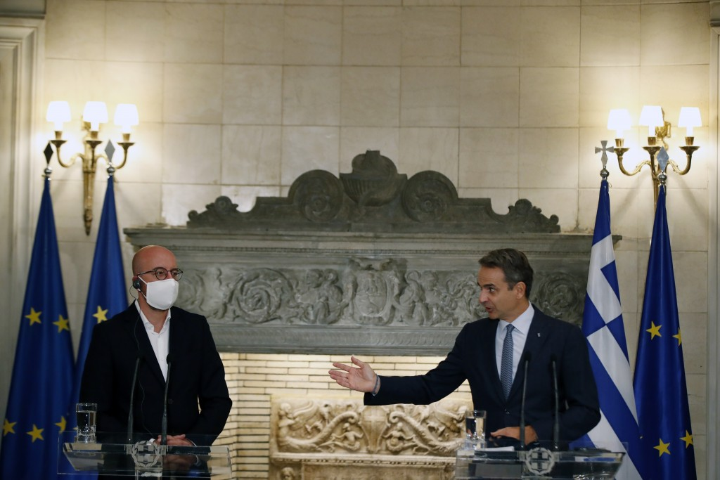 Greece's Prime Minister Kyriakos Mitsotakis , right, makes statements after his meeting with European Council President Charles Michel at Maximos Mans...
