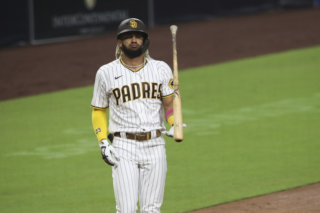 San Diego Padres' Fernando Tatis Jr. flips his bat after striking out against Los Angeles Dodgers starting pitcher Clayton Kershaw in the third inning...