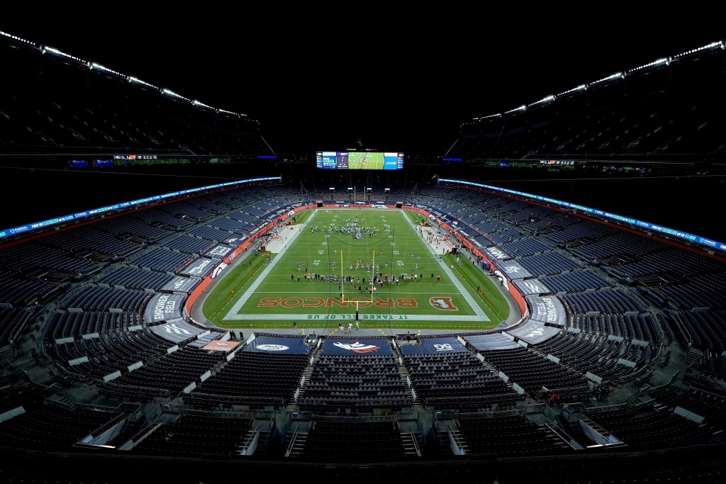 The Denver Broncos and the Tennessee Titans take the field in an empty stadium prior to an NFL football game, Monday, Sept. 14, 2020, in Denver. (AP P...