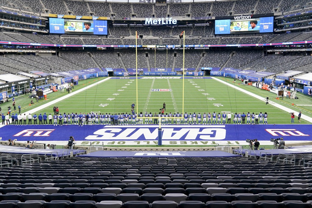 New York Giants players line up on the field for a video tribute to Black history before playing against the Pittsburgh Steelers in an NFL football ga...