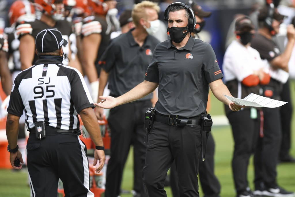 FILE - Cleveland Browns head coach Kevin Stefanski discusses a call with an official in the second half during an NFL football game against the Baltim...