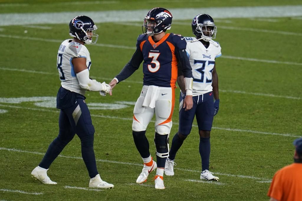 Denver Broncos quarterback Drew Lock (3) greets Tennessee Titans linebacker Harold Landry after an NFL football game, Monday, Sept. 14, 2020, in Denve...