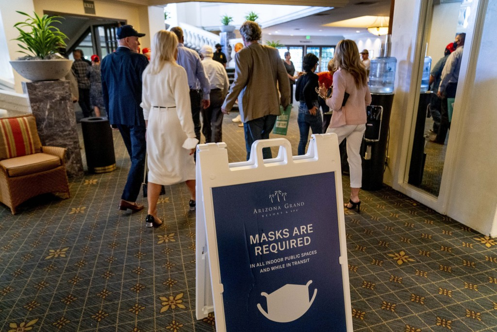 """A sign reads """"Masks Are Required"""" outside a Latinos for Trump Coalition roundtable where President Donald Trump spoke at Arizona Grand Resort & Spa, M..."""