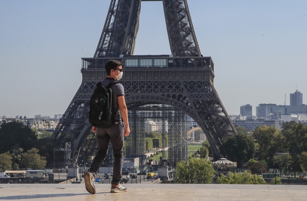A man wearing protective a face mask as precaution against the conoravirus walk at Trocadero plaza near Eiffel Tower in Paris, Monday, Sept. 14, 2020....