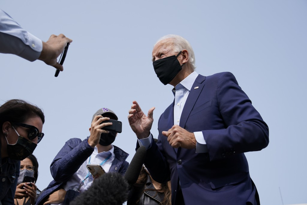 Democratic presidential candidate and former Vice President Joe Biden arrives and speaks to the media before boarding a plane at New Castle Airport in...