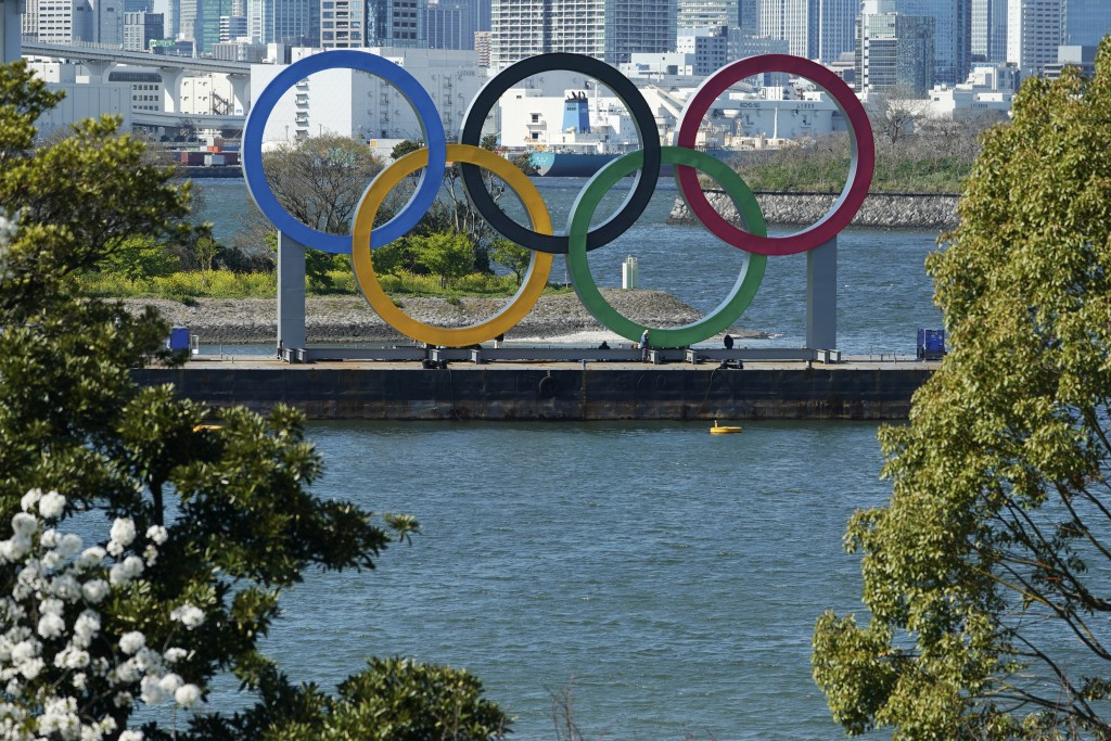 The Olympic rings is seen at Tokyo's Odaiba district Tuesday, March 24, 2020. The CEO of the Tokyo Olympics and the IOC member in charge of Japan's ga...