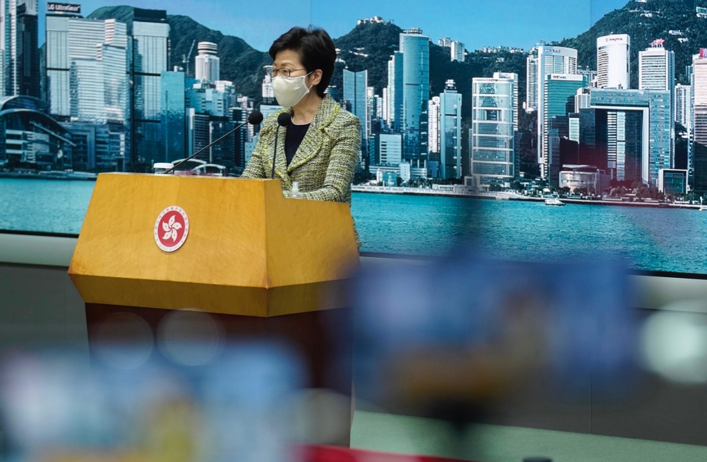 Hong Kong Chief Executive Carrie Lam listens to reporters' questions during a press conference in Hong Kong, Tuesday, Sept. 15, 2020.  Lam said Tuesda...