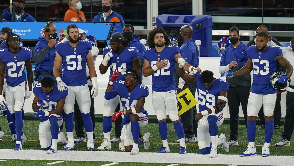 New York Giants players kneel on the field before playing against the Pittsburgh Steelers in an NFL football game Monday, Sept. 14, 2020, in East Ruth...