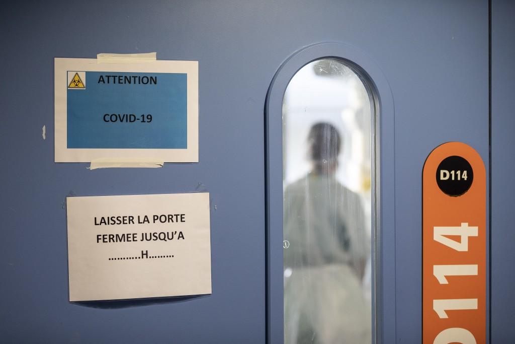A nurse is seen in a COVID-19 area of the Nouvel Hospital Civil of Strasbourg, Eastern France, Tuesday, Sept.15, 2020. France is grappling with the do...