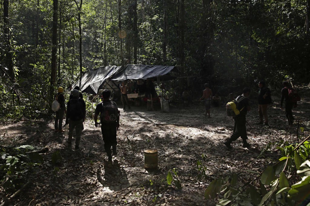 Tenetehara Indigenous men from the Ka'Azar, or Forest Owners, surround a camp of illegal loggers they discovered while patrolling their lands on the A...