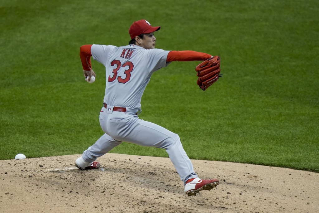 St. Louis Cardinals starting pitcher Kwang Hyun Kim throws during the third inning of the first game of a baseball doubleheader against the Milwaukee ...