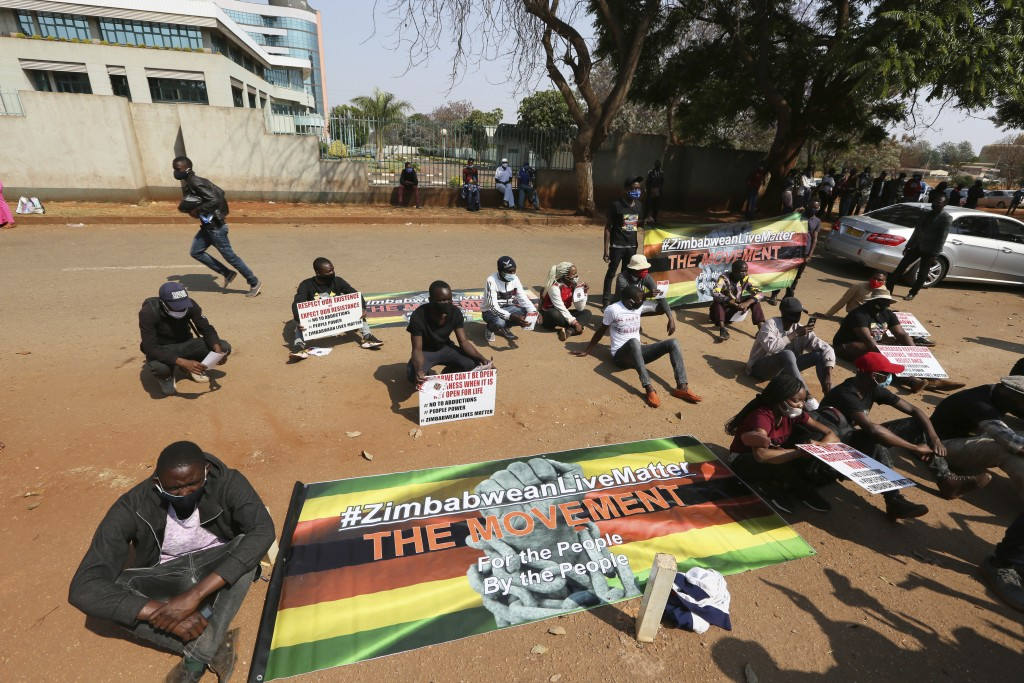 Students and human rights activists take part in a peaceful protest in Harare, Monday, Sept. 14, 2020. Human rights defenders say it appears the gover...