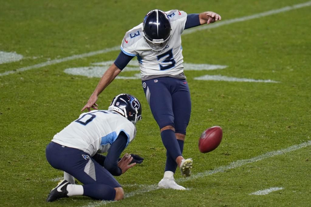 Tennessee Titans kicker Stephen Gostkowski (3) kicks the game winning field goal as punter Brett Kern (6) holds during the second half of an NFL footb...