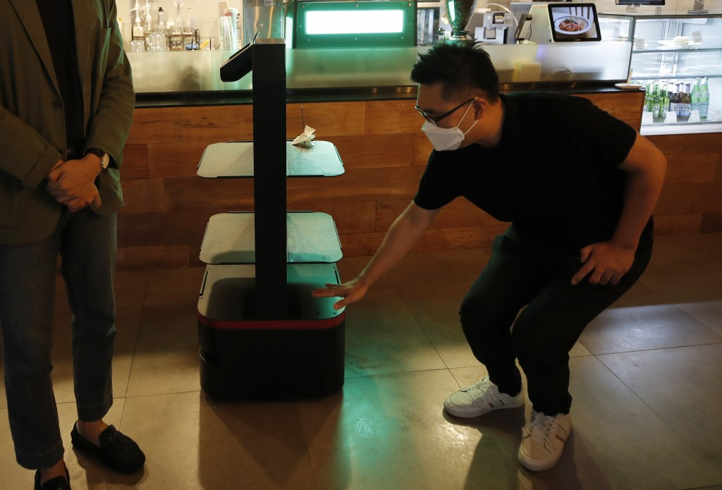 Lee Youngjin, team leader of AI Platform Business Team at KT Corp., speaks about AI serving robot ahead of a demonstration at a restaurant in Seoul, S...