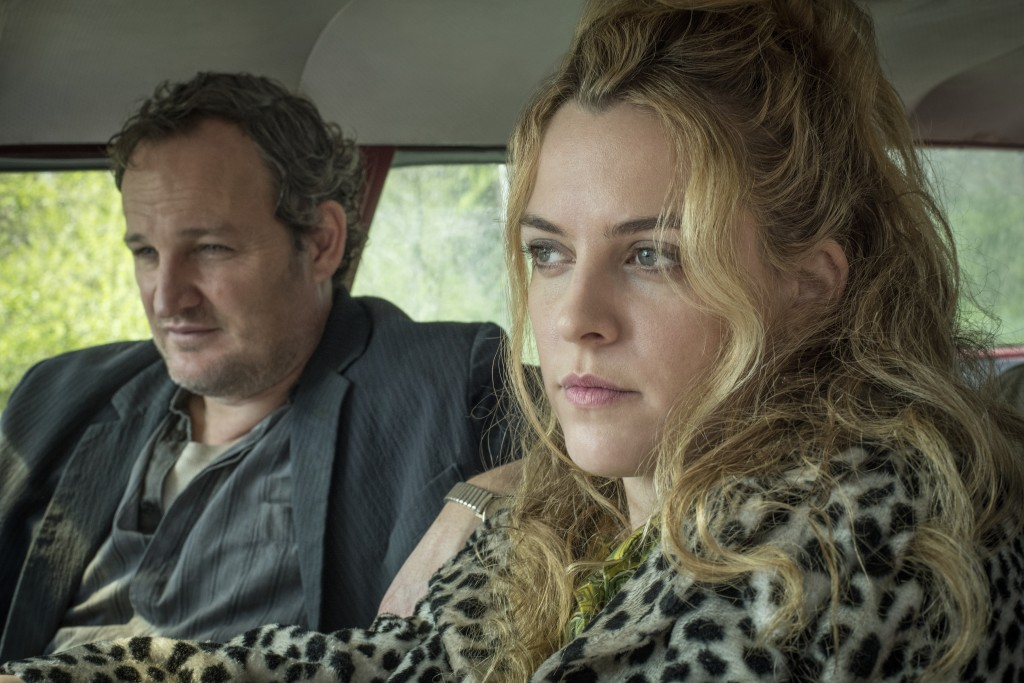 "This image released by Netflix shows Jason Clarke, left, and Riley Keough in a scene from ""The Devil All The Time."" (Glen Wilson/Netflix via AP)"