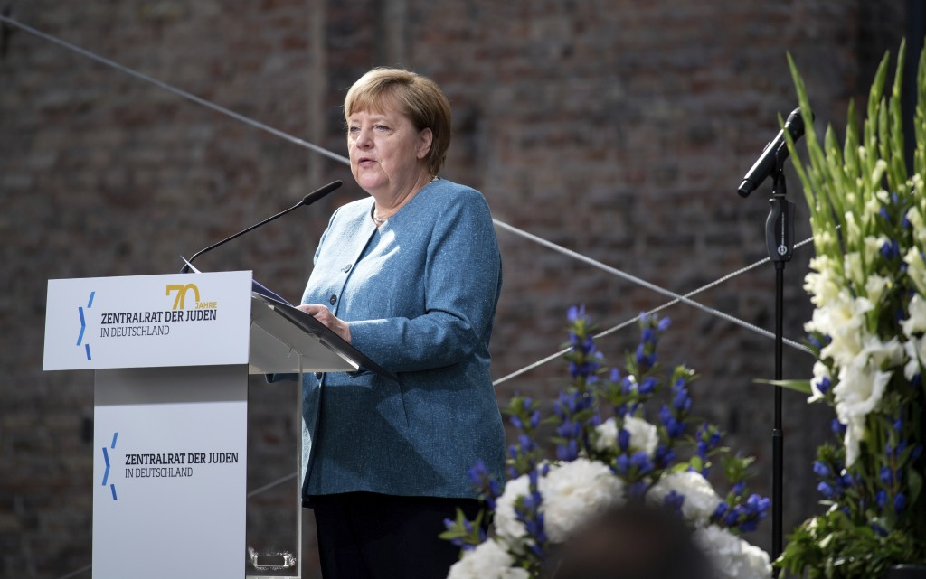 Chancellor Angela Merkel speaks at the ceremony to mark the 70th anniversary of the Central Council of Jews in the courtyard of the New Synagogue in B...