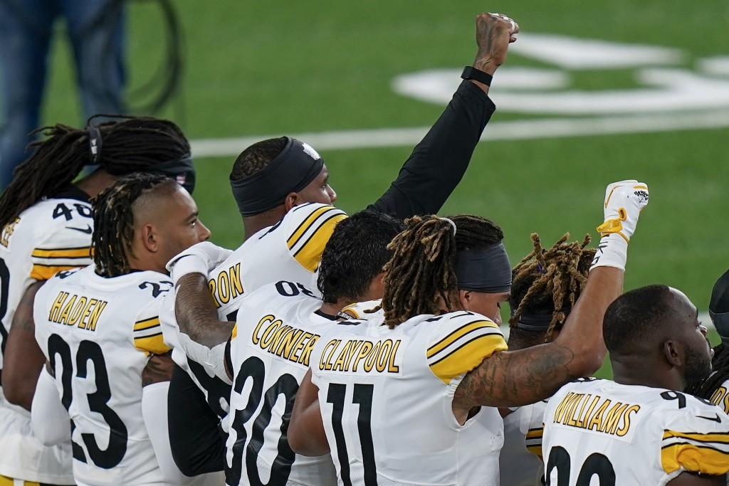 Pittsburgh Steelers players react during the national anthem before playing against the New York Giants in an NFL football game Monday, Sept. 14, 2020...