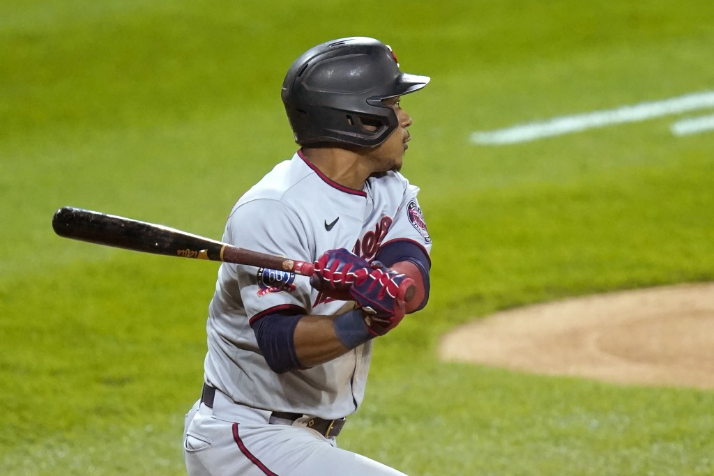 Minnesota Twins' Jorge Polanco watches his RBI-single off Chicago White Sox starting pitcher Dylan Cease during the fifth inning of a baseball game Mo...