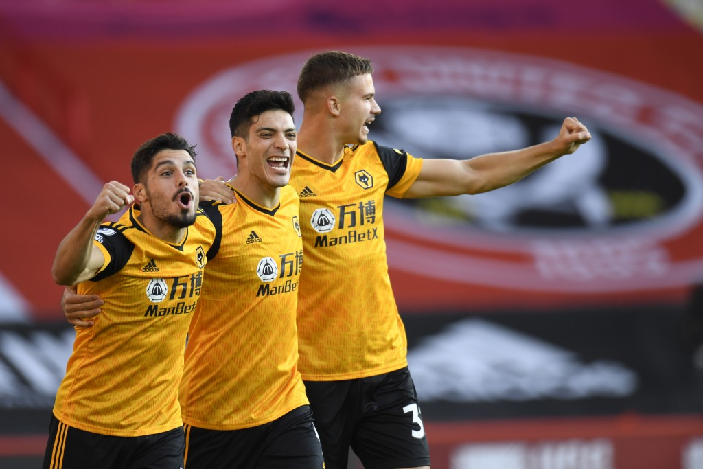 Wolverhampton Wanderers' Raul Jimenez, centre, celebrates scoring his sides first goal during the English League Cup soccer match between Sheffield Un...