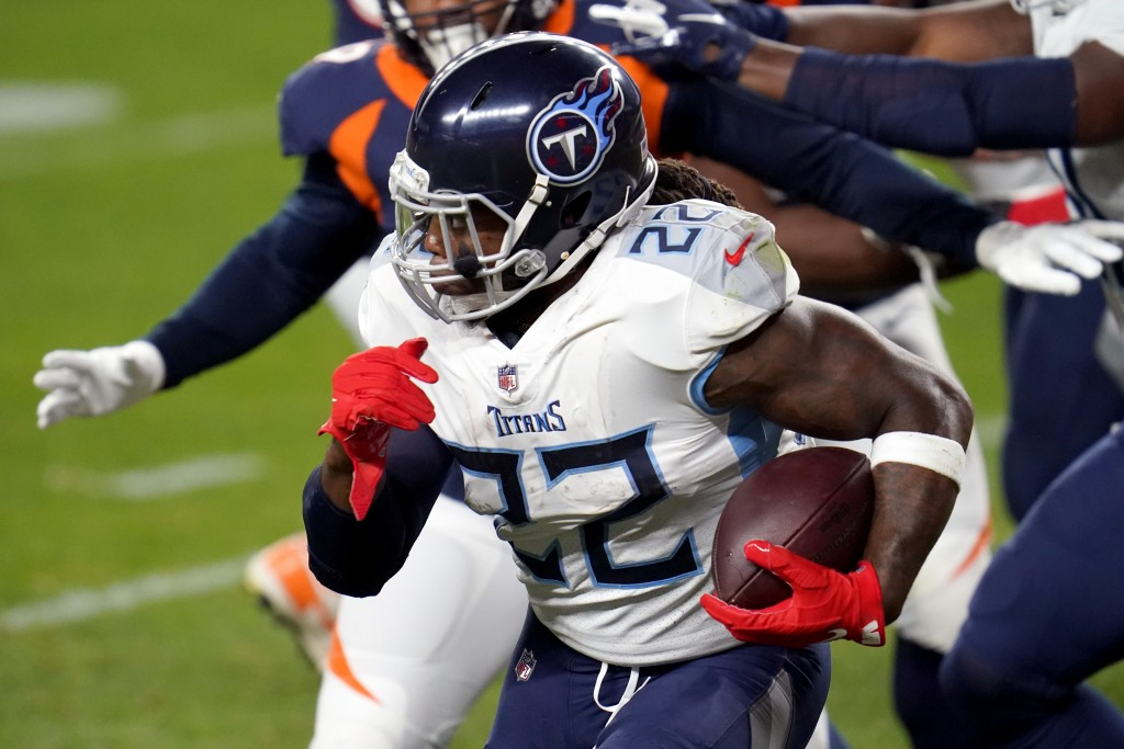 Tennessee Titans running back Derrick Henry (22) runs during the first half of an NFL football game against the Denver Broncos, Monday, Sept. 14, 2020...