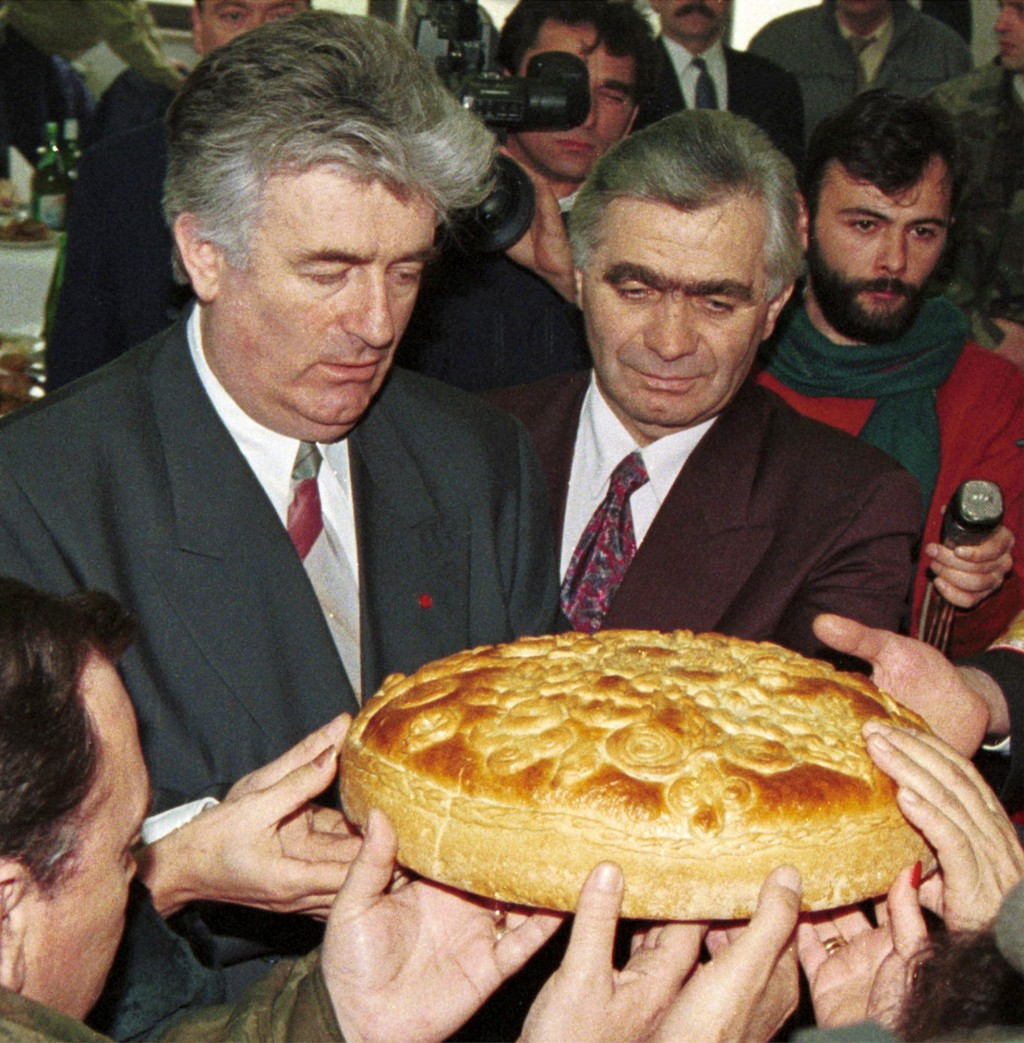 FILE - In this Jan. 9, 1996 file photo, Bosnian Serb wartime leader Radovan Karadzic, left, and Serb member of Bosnian Presidency Momcilo Krajisnik ro...