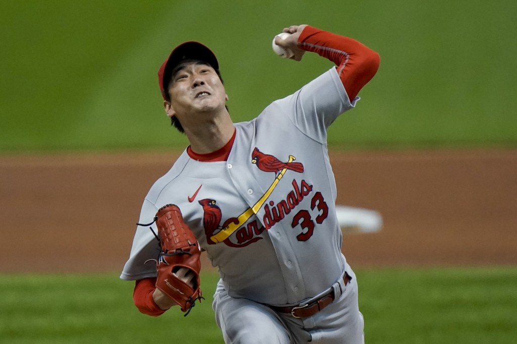 St. Louis Cardinals starting pitcher Kwang Hyun Kim throws during the first inning of the first game of a baseball doubleheader against the Milwaukee ...