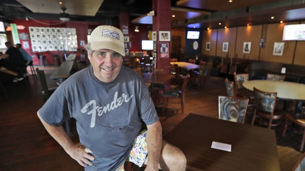 Mike Miller, owner of Wilbert's Food & Music, poses in an almost empty restaurant before a baseball game between the Minnesota Twins and the Cleveland...