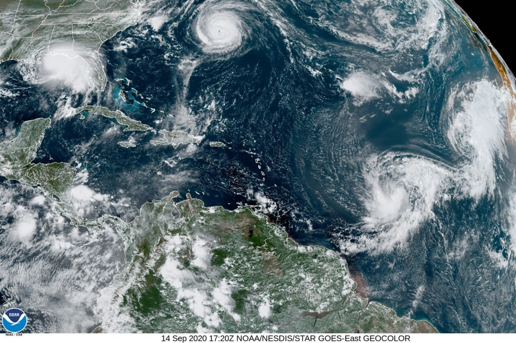 This satellite image provided by the NOAA shows five tropical cyclones churning in the Atlantic basin at 5:20 p.m. GMT on Monday, Sept. 14, 2020. The ...