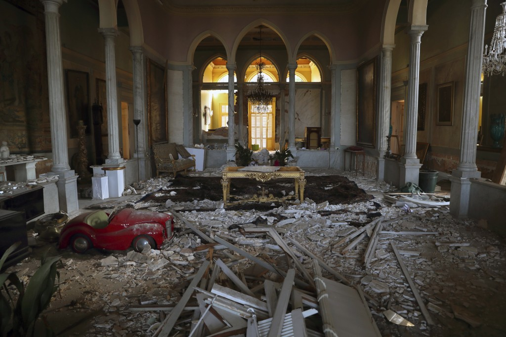 Debris from the ceiling and walls cover the floor of a room in the 150-year-old Sursock Palace that was damaged by the Aug. 4 explosion that hit the s...